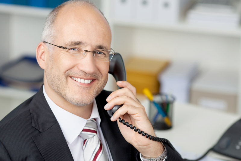 Business person using NEWT business phone